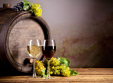 wine glasses, grapes and wine barrel