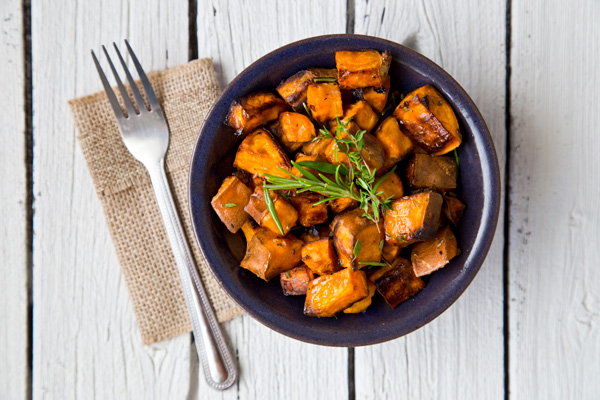 bowl of Maple Glazed Sweet Potato and a fork