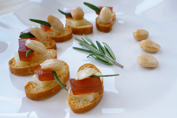 Draeger's Manchego, Quince & Almond Crostini