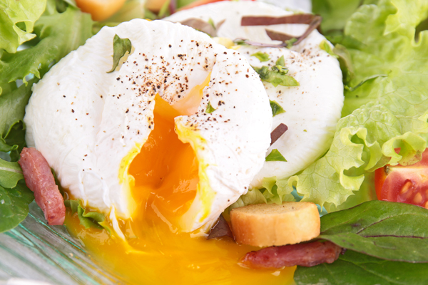 Poached Eggs with Garlic Croutons on Spring Mix